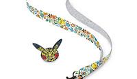 Un Pin's Pokémon avec son cordon