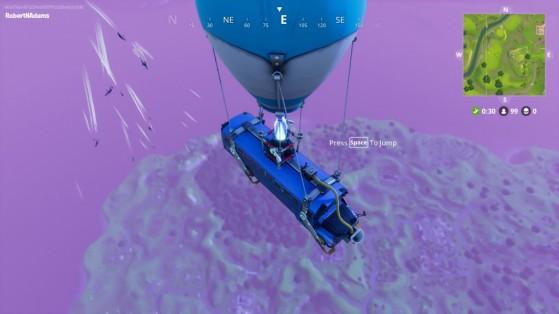 Le bus de combat survole l'île, et les joueurs s'élancent. - Fortnite : Battle royale