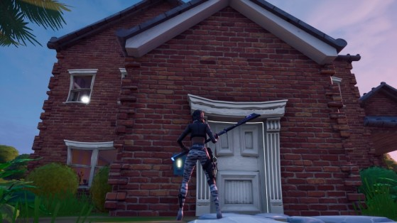 Fortnite : Sonner à la porte d'une maison dans laquelle se trouve un adversaire