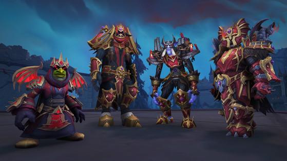 Ensembles de transmogrification d'armure en tissu (gauche), cuir (deuxième en partant de la gauche), mailles (deuxième en partant de la droite) et plaques (droite) - World of Warcraft